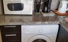 Villa F33. Kitchen. Washing mashine and microwave oven BEKO.