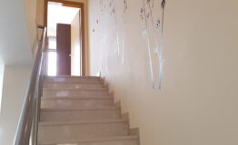 Villa F33. Stairs on the second floor.